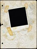 Papel manchado da folha solta com Polaroid Imagem de Stock
