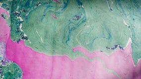 Papel marmoreado decorativo verde e do roxo fotografia de stock