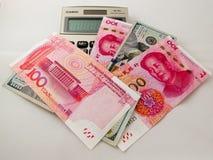 Papel moeda do dólar americano de RMB e Foto de Stock Royalty Free