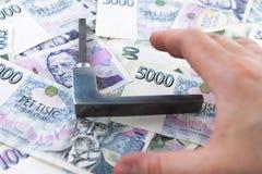 Papel moeda e punho checos imagem de stock royalty free