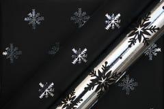 Papel negro de la Navidad Imagen de archivo libre de regalías
