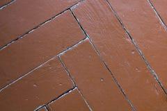 Papel pintado abstracto, piso de entarimado pintado, entarimado de raspa de arenque, fondo marrón Foto de archivo libre de regalías