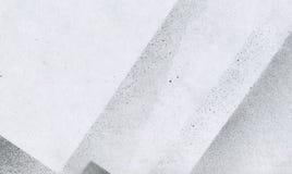 Papel pintado con efecto del aerógrafo Textura negra del movimiento de la pintura acrílica en el Libro Blanco Arte dispersado del Foto de archivo