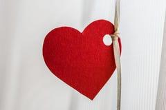 Papel pintado de papel rojo del corazón fotos de archivo