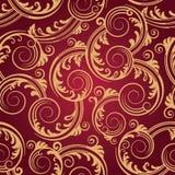 Papel pintado inconsútil de los remolinos del rojo y del oro Foto de archivo libre de regalías