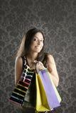 Papel pintado retro de los bolsos coloridos de la mujer de Shopaholic Foto de archivo libre de regalías