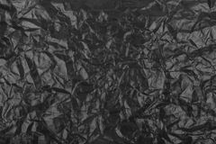 Papel: preto, amarrotado. Fotografia de Stock