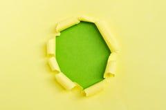 Papel rasgado amarillo Fotos de archivo libres de regalías