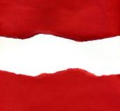Papel rasgado vermelho que revela um fundo branco Fotografia de Stock Royalty Free
