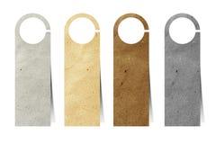 Papel reciclado escrituras de la etiqueta de la puerta Fotografía de archivo libre de regalías