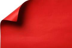 Papel rojo con la esquina encrespada Foto de archivo libre de regalías