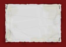 Papel sujetado con grapa rasgado Imagenes de archivo