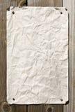 Papel sujo na parede de madeira imagens de stock royalty free