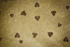 Papel Textured vintage com coração Imagens de Stock Royalty Free