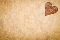 Papel Textured vintage com coração Fotografia de Stock Royalty Free