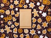 Papel vacío de la Navidad de las galletas del pan de jengibre para el canela de las naranjas del Año Nuevo de la receta Imagen de archivo