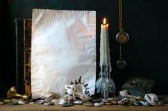 Papel velho com uma vela Fotografia de Stock Royalty Free