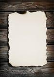 Papel velho na textura de madeira fotografia de stock