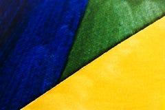 Papel verde azul amarelo imagens de stock