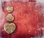 Papel vermelho do vintage com corações Imagens de Stock Royalty Free