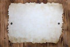 Papel viejo clavado con tachuelas Imagen de archivo libre de regalías