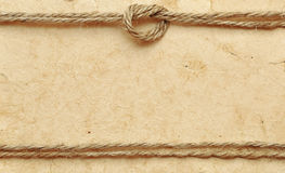 Papel viejo con la cuerda Fotos de archivo libres de regalías