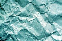Papel viejo con los wrinckles en color ciánico imagen de archivo libre de regalías