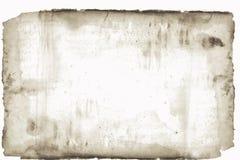 Papel viejo manchado y torned Foto de archivo libre de regalías