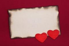 Papel y corazones quemados Fotos de archivo libres de regalías
