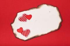 Papel y corazones quemados Foto de archivo libre de regalías