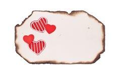 Papel y corazones quemados grunge vacío Foto de archivo libre de regalías