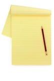 Papel y lápiz alineados amarillo Fotografía de archivo libre de regalías