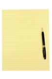Papel y pluma amarillos Fotos de archivo libres de regalías