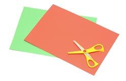Papel y tijeras del color foto de archivo