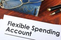 Papeles con la cuenta flexible FSA del gasto foto de archivo