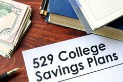Papeles con 529 planes de los ahorros de la universidad fotografía de archivo libre de regalías