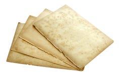 Papeles viejos de la pila aislados Imagen de archivo