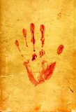 Paper 18. Sheet of the old paper which has turned yellow from time. On a sheet the bloody print left by a palm of the person is visible. The picture is Royalty Free Stock Photo