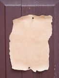 Paper. Old paper on wood door royalty free stock image