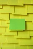 Paper. Green paper on yellow background Stock Image