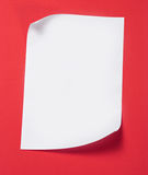 Paper. Plain note paper on textured (red)background