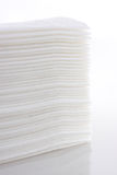 Paper. Pack soft paper on a light background. A package of white napkins Stock Photo