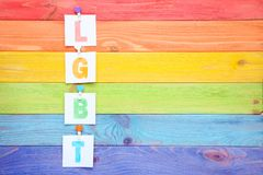 Paper with abbreviation LGBT. On colorful wooden table stock images