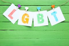 Paper with abbreviation LGBT. On green background stock photography
