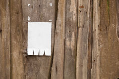 Paper ad on wooden fence Royalty Free Stock Photo