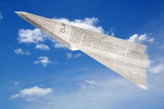 Paper Aeroplane. Made of newspaper page in flight royalty free stock photos