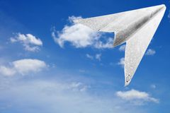 Paper Aeroplane. Made of newspaper page in flight Stock Image
