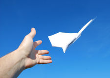 Paper aeroplane. In hands on the sky Royalty Free Stock Photography