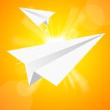 The paper aeroplane in the yellow sky Royalty Free Stock Photos