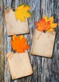 Paper affisch tre på en wood vägg Fotografering för Bildbyråer